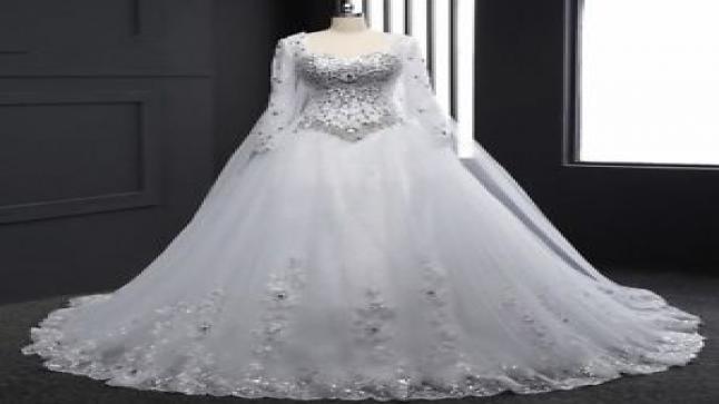 تفسير حلم الفستان الأبيض في المنام للعزباء والمتزوجة والحامل